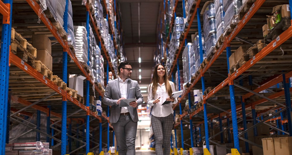 Two supply chain managers in a warehouse